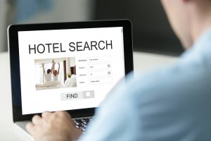 Photo of a person doing a hotel search on a laptop