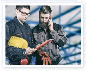 Industrial workers using mobile phone